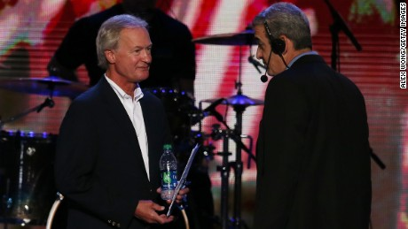 Rhode Island Gov. Lincoln Chafee, left, stands on stage with stage manager David Cove during day one of the Democratic National Convention at Time Warner Cable Arena on September 4, 2012 in Charlotte, North Carolina.