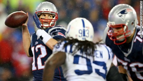 FOXBORO, MA - JANUARY 18:  Tom Brady #12 of the New England Patriots in action against the Indianapolis Colts of the 2015 AFC Championship Game at Gillette Stadium on January 18, 2015 in Foxboro, Massachusetts.  (Photo by Jim Rogash/Getty Images)