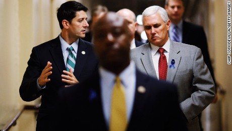Wisconsin Rep. Paul Ryan (left) talks with then-Rep. Pence (right) as they head to a Republican conference meeting in the basement of the U.S. Capitol on July 25, 2011.