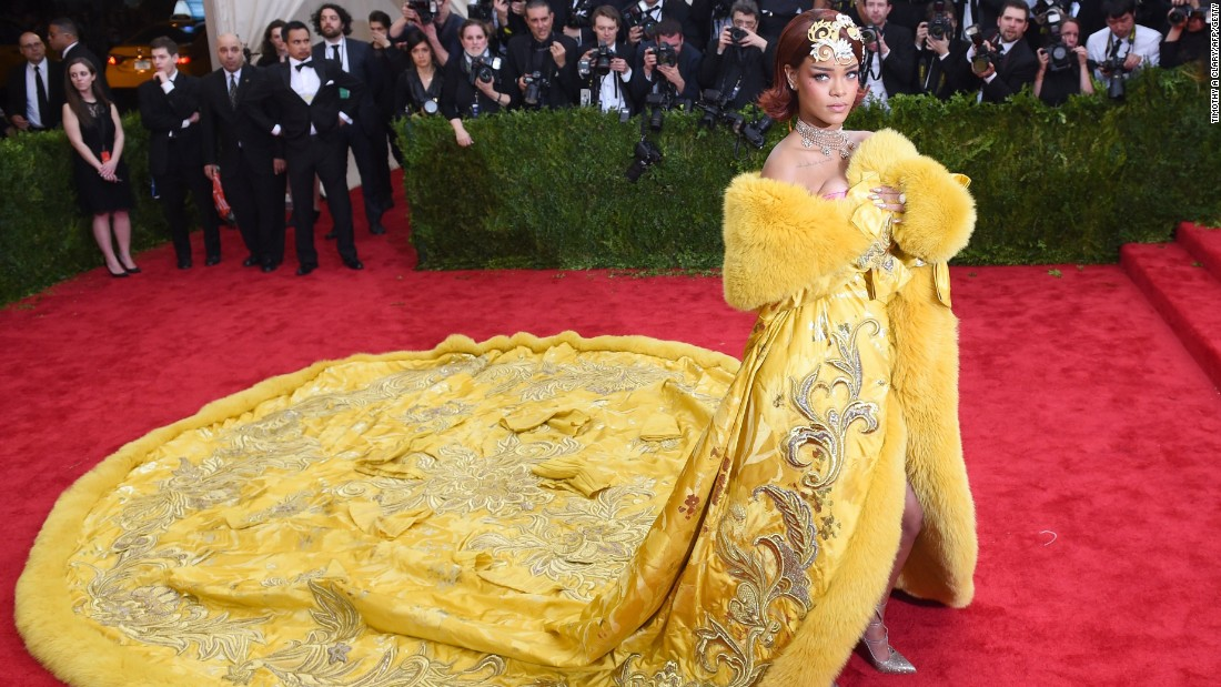 "Rihanna wore this bright yellow creation to the 2015 <a href=""http://edition.cnn.com/2016/05/02/fashion/met-gala-2016/"">Met Gala</a>. Guo Pei and her team spent around 8,000 hours working on it. The dress is made of fox fur and Italian silk, and weighs 25 kg."