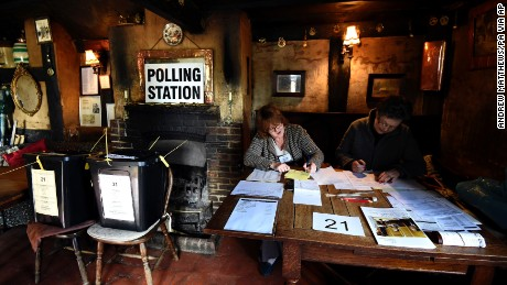 Election officials work at the polling station inside the White Horse Inn in Priors Dean, England.