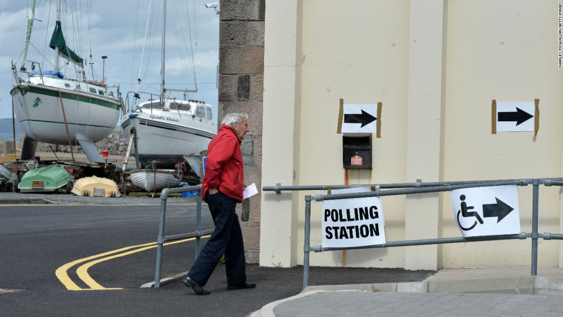 A man walks to the Groomsport boat house in Belfast, Northern Ireland, to cast his vote on Thursday, May 7.