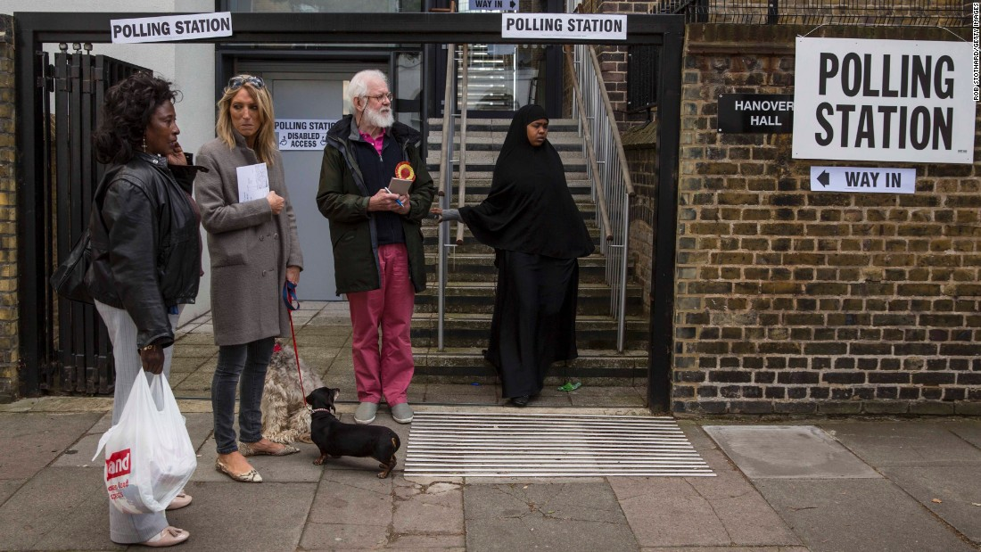 A woman leaves a polling station in the Islington neighborhood of London.
