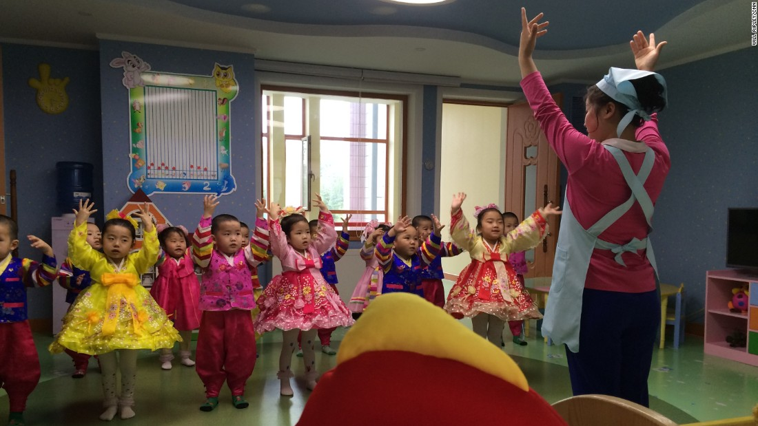 Young children in a newly constructed Pyongyang orphanage practice a musical performance, May 2015.
