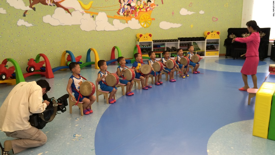 Young boys practice a drum routine that they will perform during International Children's Day.