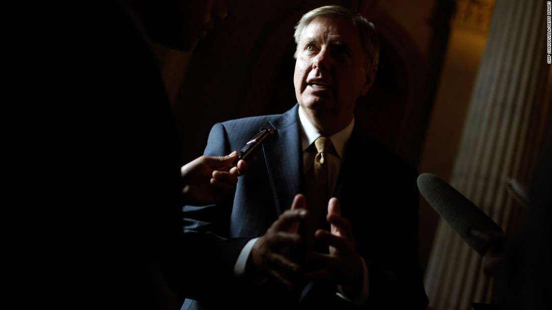 Graham talks with reporters before heading into the Senate Republican Caucus policy luncheon at the U.S. Capitol May 8, 2012.