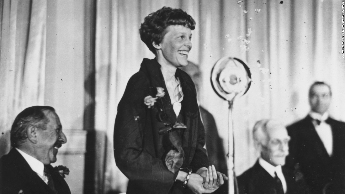 Earhart addresses journalists during a lunch in London on May 23, 1932. Her triumphant crossing was not without difficulties. Shortly after taking off from Newfoundland, she encountered thick clouds and ice on the wings of her plane. Mechanical problems later in the flight informed her decision to land in Northern Ireland.