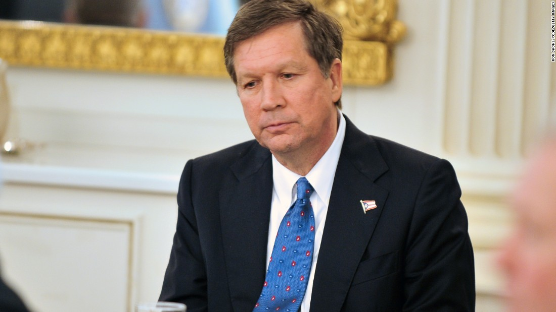 Kasich listens to Obama speak during a bipartisan meeting of governors hosted by the President and Vice President Joe Biden in the State Dining Room of the White House on February 28, 2010.