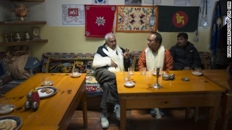 Phurba Sherpa, center, discusses the earthquake's toll with Bal Bahadur KC, left, a  member of Nepal's Parliament who represents the district in which most of the affected Sherpa villages fall.