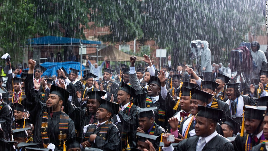 Graduates cheering the President during a heavy downpour at Morehouse College in Atlanta, Georgia, on May 19, 2013.