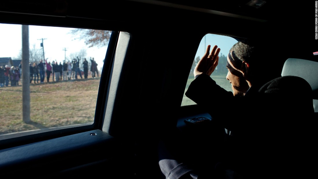 Waving to people after his economic speech in Osawatomie, Kansas, on December 6, 2011.