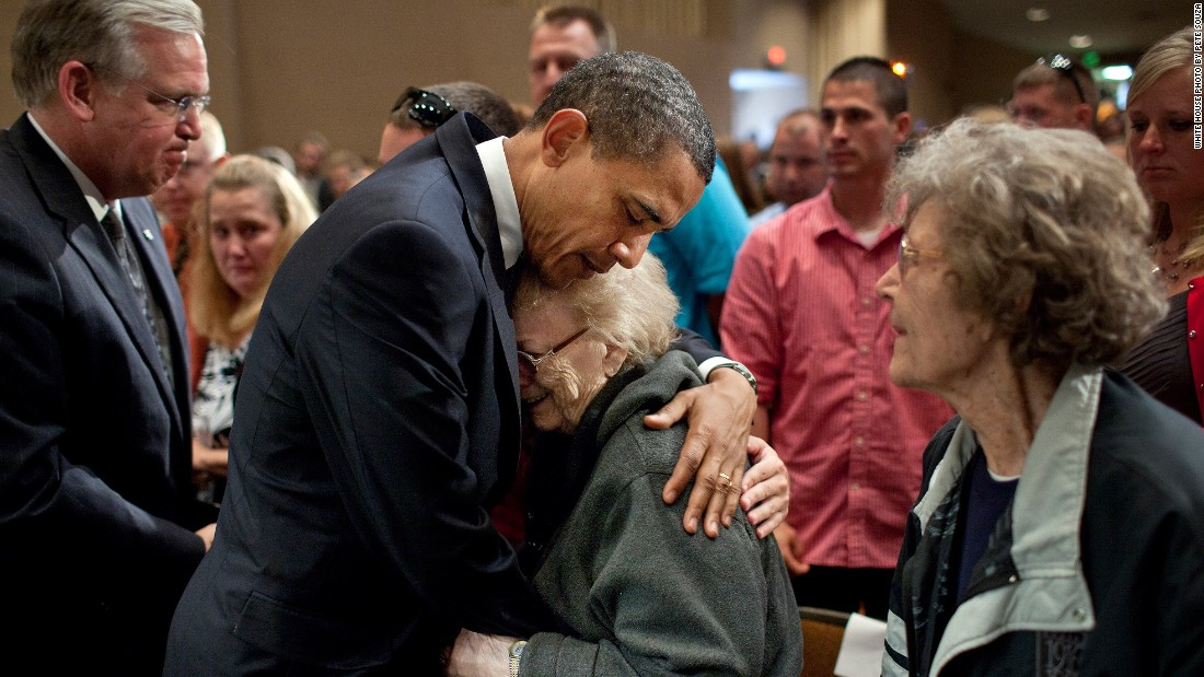 Consoling families affected by the deadly tornadoes in Joplin, Missouri, on May 29, 2011.