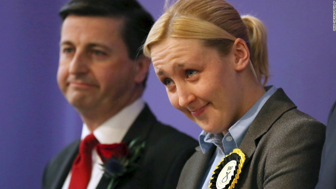 Paisley and Renfrewshire South constituency winner Mhairi Black of the Scottish National Party and the Labour Party's Douglas Alexander stand together in Paisley, Scotland, on May 8. Black, 20, became the youngest British MP since 1667 after unseating Alexander.