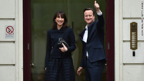 British Prime Minister and Leader of the Conservative Party David Cameron and his wife Samantha arrive at the Conservative Party headquarters in London on May 8.