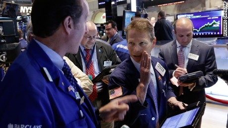 Trader Robert  Charmak, center, works on the floor of the New York Stock Exchange Thursday, May 7, 2015. U.S. stocks are opening mostly lower, pushing the Dow Jones industrial average into the red for the year.