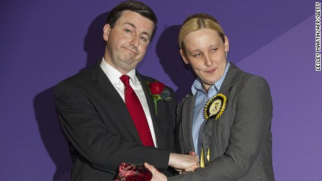 Newly elected Scottish National Party (SNP) member of parliament, Mhairi Black (R), Britain's youngest member of parliament since 1667, greets Labour candidate Douglas Alexander (L) during the declaration of the general election results for the constituency of Paisley and Renfrewshire South at the Lagoon Leisure Centre, in Paisley, west of Glasgow, Scotland on May 8, 2015.