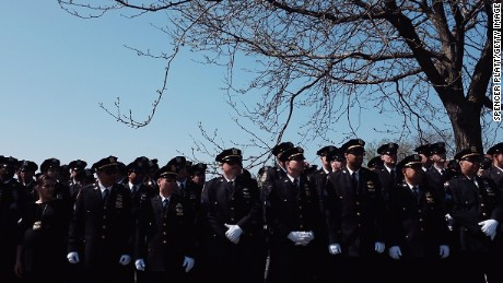 Police officers line up outside the funeral for NYPD Officer Brian Moore at St. James Roman Catholic Church.