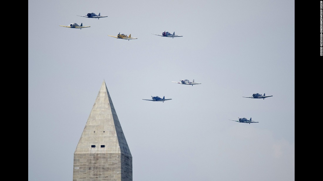World War II-era planes fly over the Washington Monument on Friday, May 8, during a celebration of the 70th anniversary of V-E (Victory in Europe) Day -- the day Germany surrendered to the Allies, ending the European phase of the war.