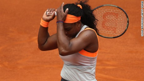 Serena Williams puts her head in her hands during the defeat by Petra Kvitova in the Madrid Open.