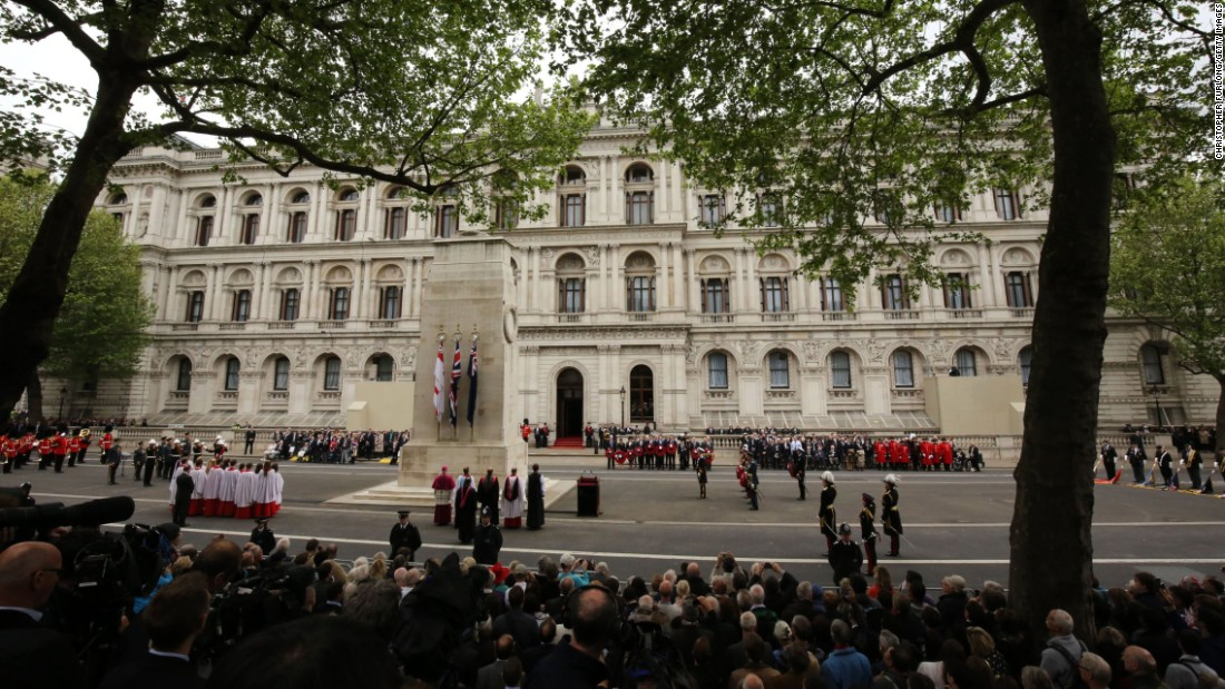 UK representatives gather for the tribute at the Cenotaph.