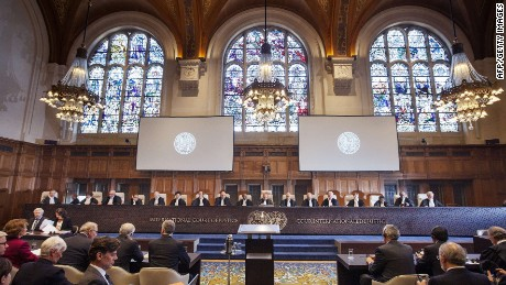 "A handout picture taken and released on May 4, 2015 by the International Court of Justice (ICJ) shows ICJ members at the opening of the hearings in the case Bolivia v. Chile (Chiles Preliminary Objection) on the access to the Pacific ocean, at the Peace Palace in The Hague. AFP PHOTO / HO / INTERNATIONAL COURT OF JUSTICE == RESTRICTED TO EDITORIAL USE - MANDATORY CREDIT ""AFP PHOTO / INTERNATIONAL COURT OF JUSTICE / ICJ-CIJ / Bastiaan van Musscher"" - NO MARKETING NO ADVERTISING CAMPAIGNS - DISTRIBUTED AS A SERVICE TO CLIENTS ==Bastiaan van Musscher/AFP/Getty Images"