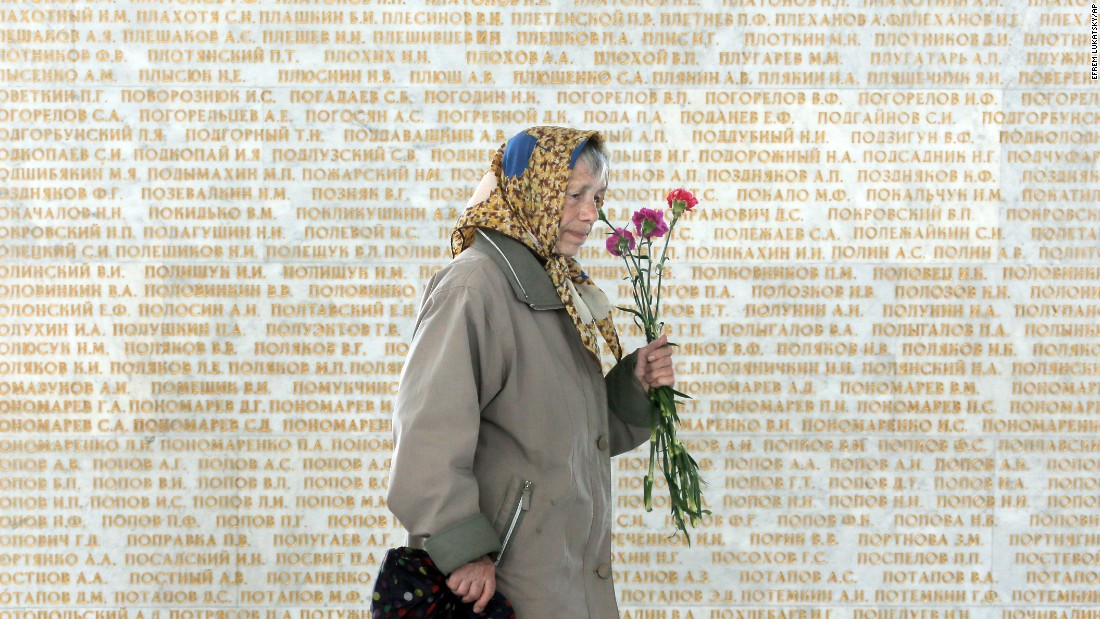 An elderly woman passes by a wall engraved with the names of the Soviet Union Heroes, during the 70th anniversary of the victory over Nazi Germany, in Ukraine's capital Kiev, on May 9. Ukrainians mark the World War II anniversary and Victory Day on May 9 as a national holiday.