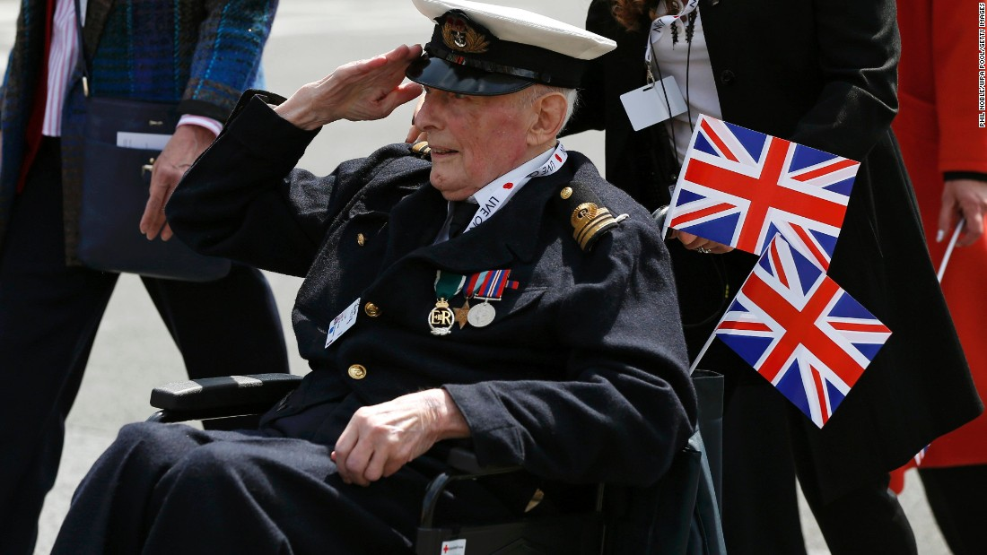 A veteran salutes during an armed forces and veterans' parade in London on Sunday, May 10, the final day of commemoration of the 70th anniversary of Victory in Europe day.