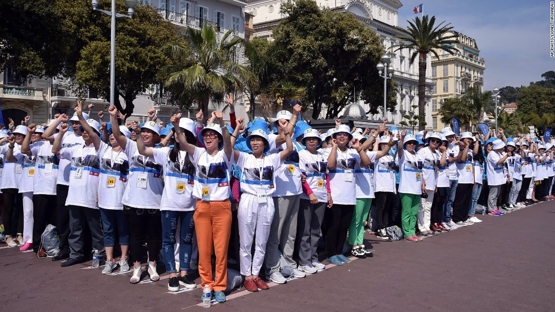 The employees stood together to break a Guinness World Record for the largest human sentence on the Promenade des Anglais in Nice, southeastern France on May 8.