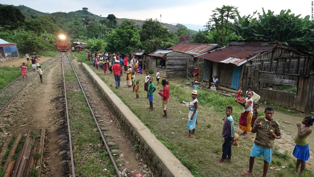 This is one of 17 train stops along the 100-mile journey from Tana to the coastal town of Manakara. Locals await the train's arrival to unload much needed rice, beans, bananas and other fruits and vegetables.