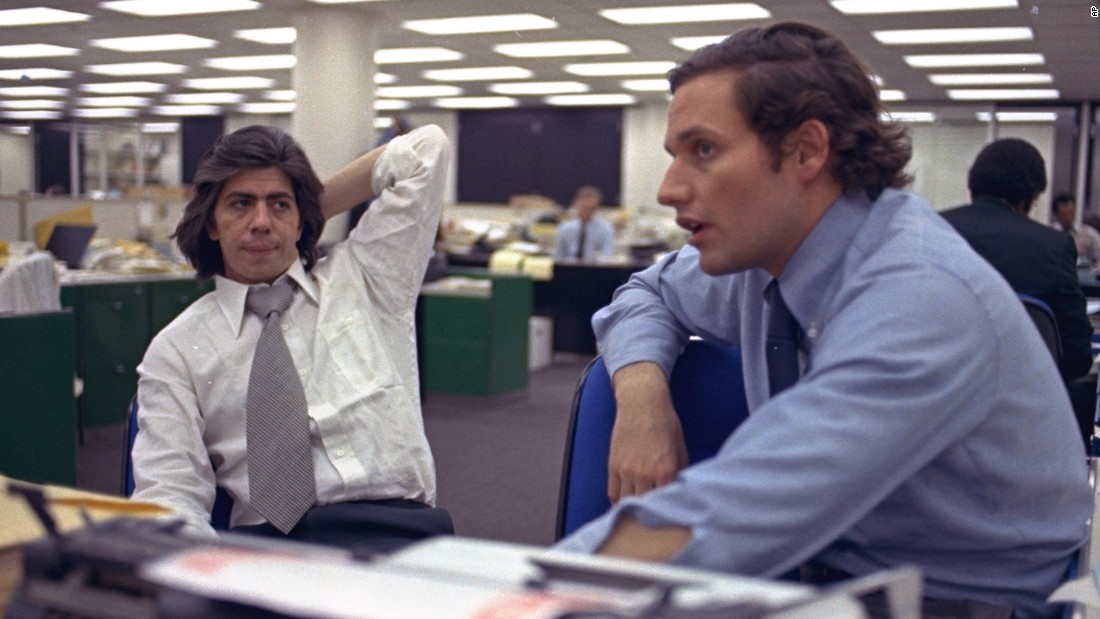 "Reporters Bob Woodward, right, and Carl Bernstein sit in the newsroom of the Washington Post newspaper in May 1973. Woodward and Bernstein's reporting on the Watergate scandal led to President Nixon's resignation and won them a Pulitzer Prize. In 1976, Robert Redford and Dustin Hoffman would portray the pair in the film adaptation of their book ""All the President's Men."""