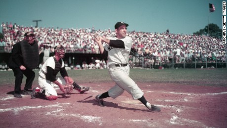 Yogi Berra swings the bat during a baseball game circa 1955. (Photo by Getty Images/Getty Images)