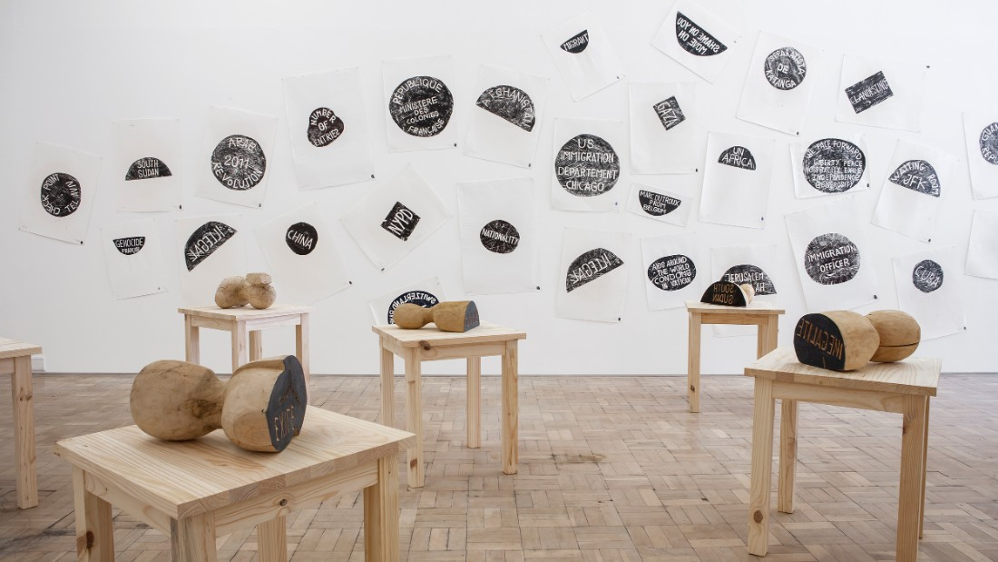 <em>Barthélémy Toguo, The New World Climax, 2000--2014. </em><br /><br />The Cameroonian artist often works with a mix of media -- prints, still images, video and sculpture. But one of his offerings at this year's exhibition is using wooden stamps, tables, ink prints on paper.