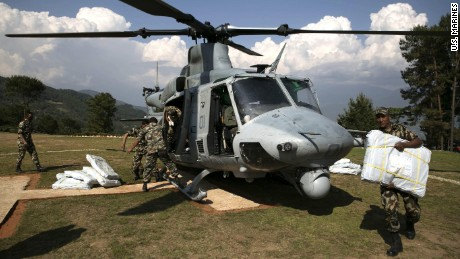 Nepali military service members unload supplies from a UH-1Y Huey in Charikot, Nepal, on May 5.