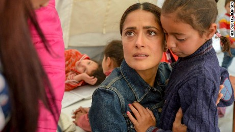"A handout picture released by UNICEF and taken on April 25, 2015, shows Mexican-US actress Salma Hayek (C) visiting an informal Syrian refugee camp in Lebanon's eastern Bekaa Valley as she campaigns with UNICEF to raise funds for Syrian refugees. Hayek is also in Lebanon to promote her film ""The Prophet"". AFP PHOTO / UNICEF / SEBASTIAN RICH === RESTRICTED TO EDITORIAL USE - MANDATORY CREDIT ""AFP PHOTO / UNICEF / SEBASTIAN RICH"" - NO MARKETING NO ADVERTISING CAMPAIGNS - DISTRIBUTED AS A SERVICE TO CLIENTS ===SEBASTIAN RICH/AFP/Getty Images"