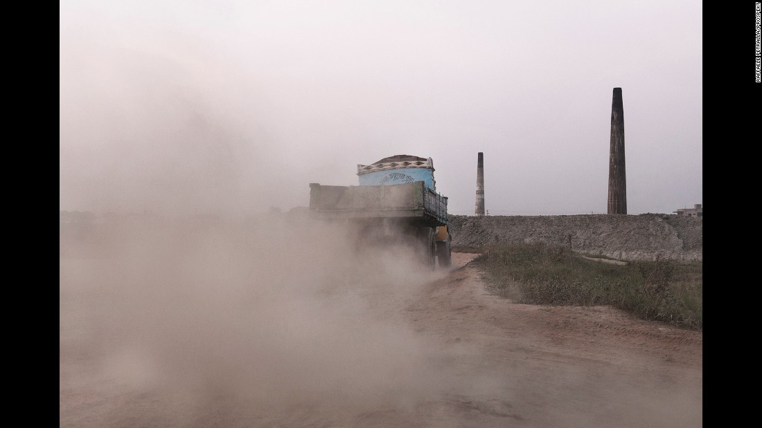 The trucks that load bricks add to the pollution and dust in the area.