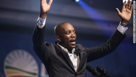 Mmusi Maimane, the newly elected leader of South Africa's main opposition Democratic Alliance (DA) party, gestures as he gives his maiden speech following his election in Port Elizabeth, South Africa, on May 10, 2015.