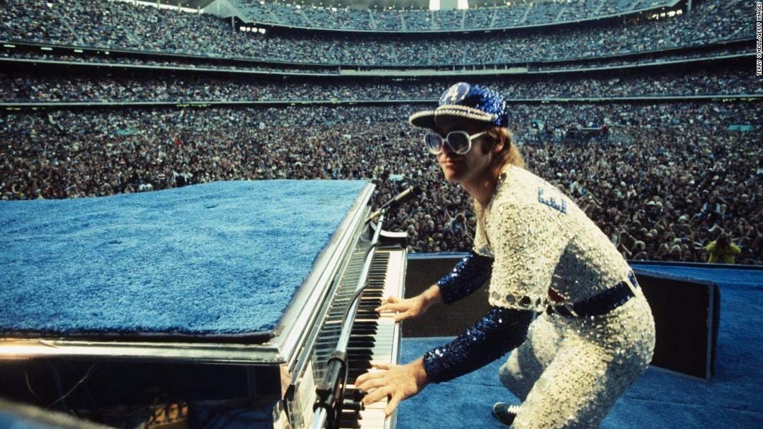 English singer Elton John, one of the biggest artists of the '70s, performed two sold-out shows at Los Angeles' Dodger Stadium in October 1975, performing for more than three hours each night. John, known for his flamboyant outfits and oversized sunglasses, was decked out for the occasion in a sequined Dodgers baseball uniform.