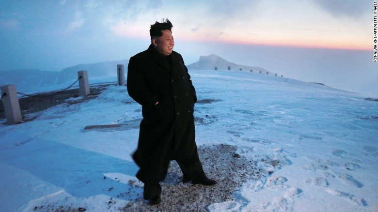 A photo released by North Korea's official Korean Central News Agency (KCNA) on April 20, 2015, shows North Korean leader Kim Jong Un on a snow-covered Mount Paektu during sunrise.
