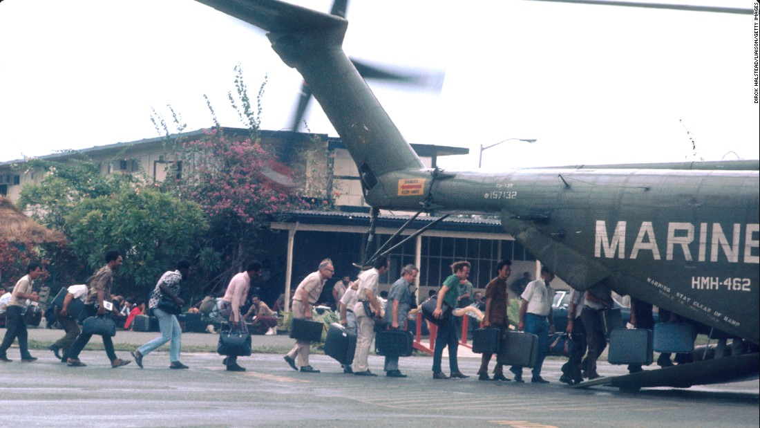 In April 1975, the fall of Saigon to the North Vietnamese effectively marked the end of the Vietnam War. Here, U.S. Marines guard civilians during evacuations at Tan Son Nhut airbase. The country became the Socialist Republic of Vietnam on July 2, 1976.