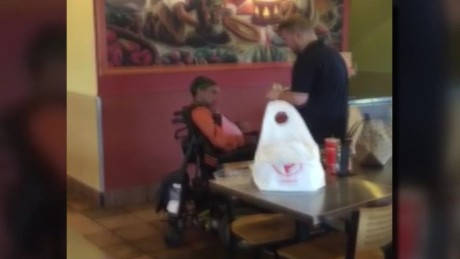 restaurant employee feeds disabled guest_00011513