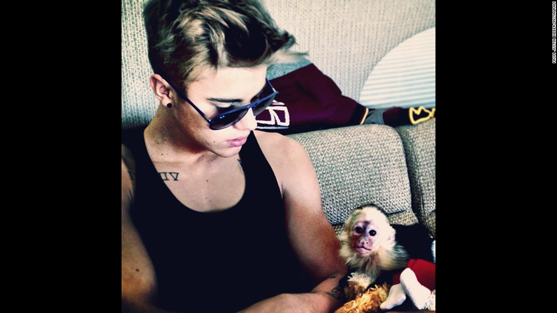"Justin Bieber poses with his pet capuchin monkey, ""Mally,"" in a photo he posted on Instagram. <a href=""http://cnn.com/2013/06/27/world/europe/germany-justin-bieber-monkey/index.html"">The monkey was seized by German customs </a>officials in March 2013 after the singer brought it on tour without the right paperwork."