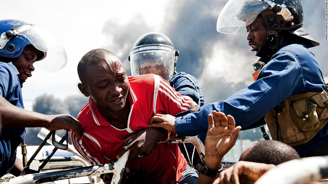 Police grab a man at a protest in Bujumbura on Wednesday, May 13.