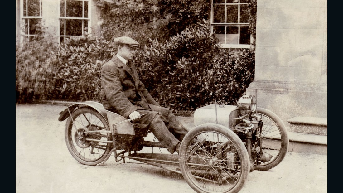 Company founder Henry Morgan with his inaugural three-wheeler design in 1909.