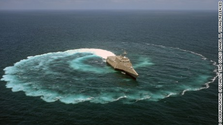 "The littoral combat ship USS Independence (LCS 2) demonstrates its maneuvering capabilities in the Pacific Ocean off the coast of San Diego. LCS crew commander John Kochendorfer described the ships as ""a military jet ski with a flight deck and a gun."