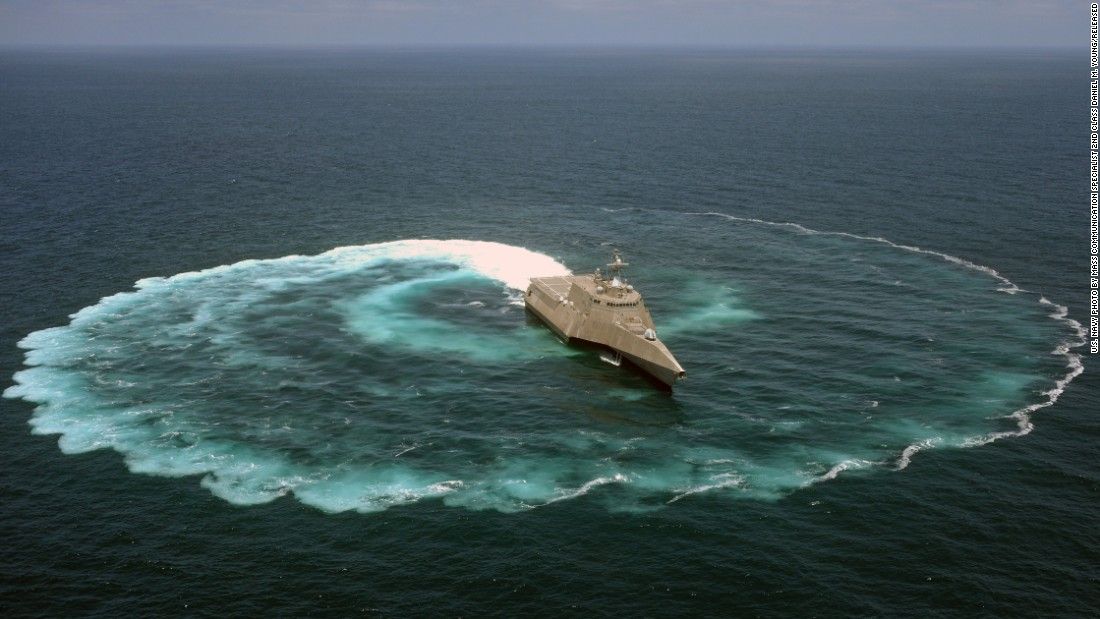 "The USS Independence is the first in the trimaran variant of littoral combat ships.<br /> <br />Described by one LCS crew commander as ""a military jet ski with a flight deck and a gun,"" the LCS has a draft of 15 feet or less, meaning it can operate in waters not much deeper than that, with a top speed of 40 knots.<br /> <br />The ships are also designed to provide flexibility in operations and missions.<br /> <br />The LCS sea frames will be outfitted with ""reconfigurable payloads, called mission modules (made up of mission systems and support equipment), which can be changed out quickly,"" according to the Navy, to accomplish missions including mine countermeasures, anti-submarine warfare and surface warfare."