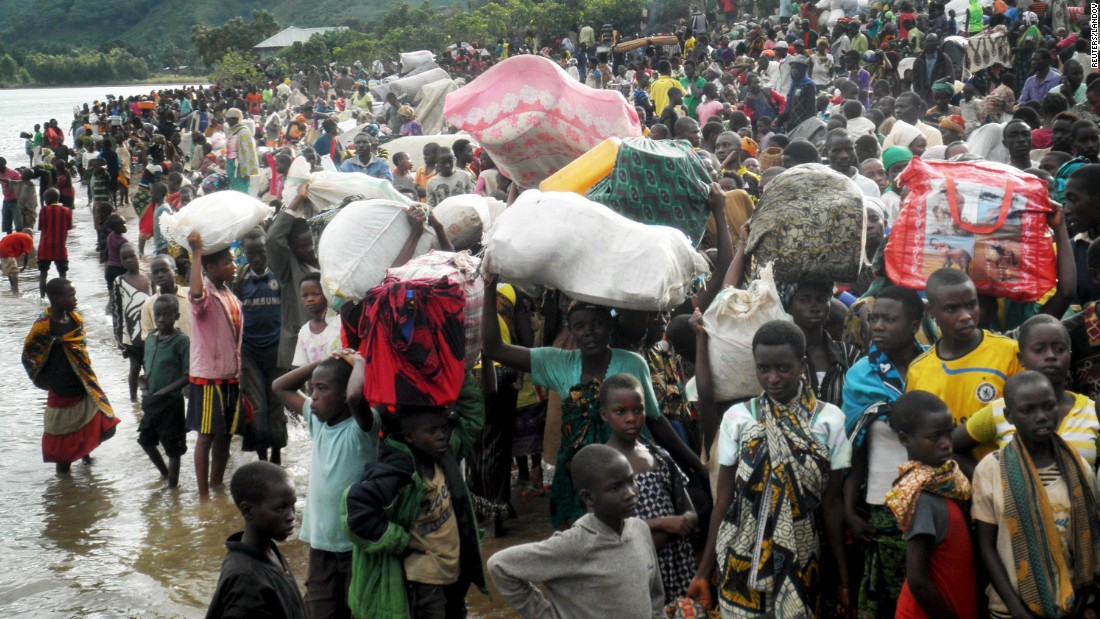 Burundian refugees gather at the shore of Lake Tanganyika in western Tanzania as they wait for a ferry to take them to Kigoma township on Tuesday, May 12. Government officials in Tanzania told local media that at least 80,000 refugees have arrived in Kigoma since Burundi's pre-election skirmishes began.