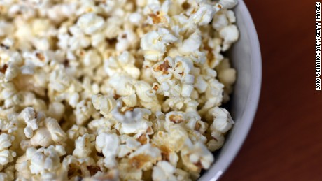 A picture taken on February 10, 2015 in Paris shows a bowl of popcorn. To most people, it may be just a fun food to munch while watching a movie.  But to a couple of French investigators, popcorn is a biomechanical enigma waiting to be explained.  In an unusual study published on February 11, engineers Emmanuel Virot and Alexandre Ponomarenko carried out experiments into what makes popcorn, well, pop.  Cameras recording at 2,900 frames per second helped show what happened when a kernel of corn strutted its stuff.      AFP PHOTO / LOIC VENANCE        (Photo credit should read LOIC VENANCE/AFP/Getty Images)