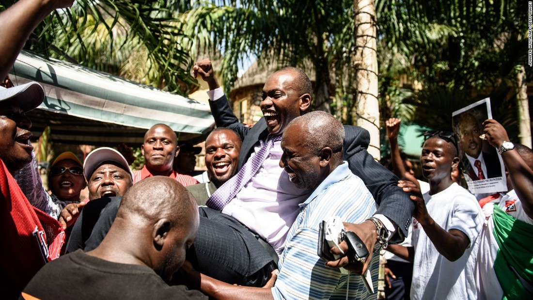 Government spokesman Willy Nyamitwe is carried by supporters in Bujumbura on Friday, May 15, as people celebrate Nkurunziza's return after the failed coup attempt.