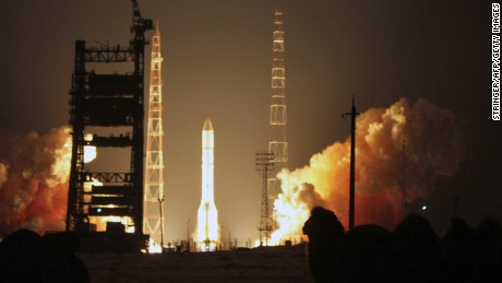 Caption:Russian-built Proton-M rocket with the Turksat-4A Turkish communications satellite blasts off at the Russian leased Kazakhstan's Baikonur cosmodrome on February 15, 2014. AFP PHOTO/STRINGER (Photo credit should read STRINGER/AFP/Getty Images)