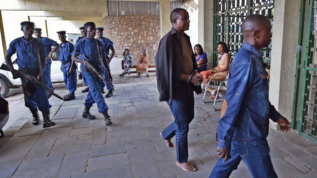Gen. Niyungeko Juvenal, at center in handcuffs, is taken to the Supreme Court in Bujumbura on May 16. Seventeen alleged coup plotters appeared before a prosecutor.